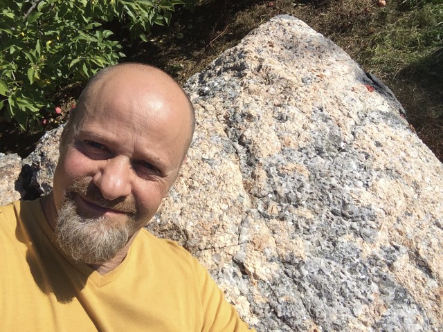 Kyle Russell in front of pyramidal Granite